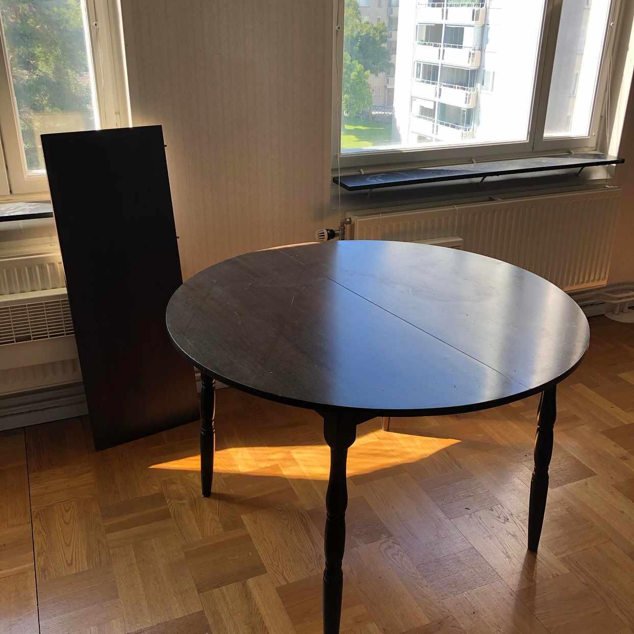image of Brunt köksbord med utdrag - Stockholm