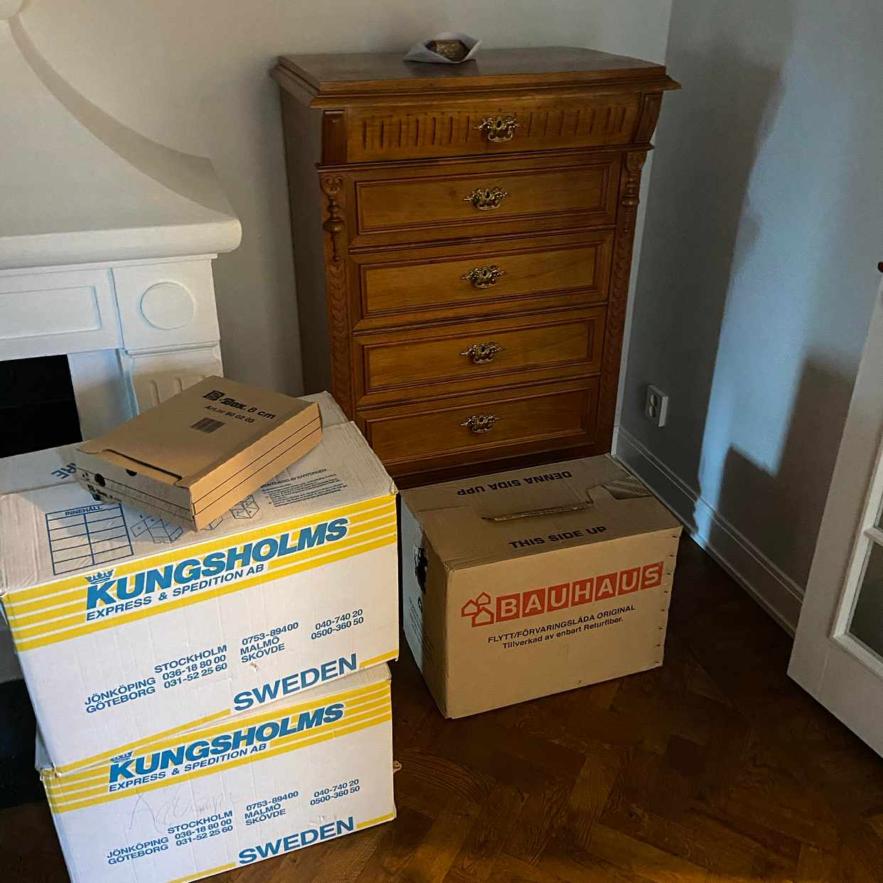 image of A dresser and 3 boxes -