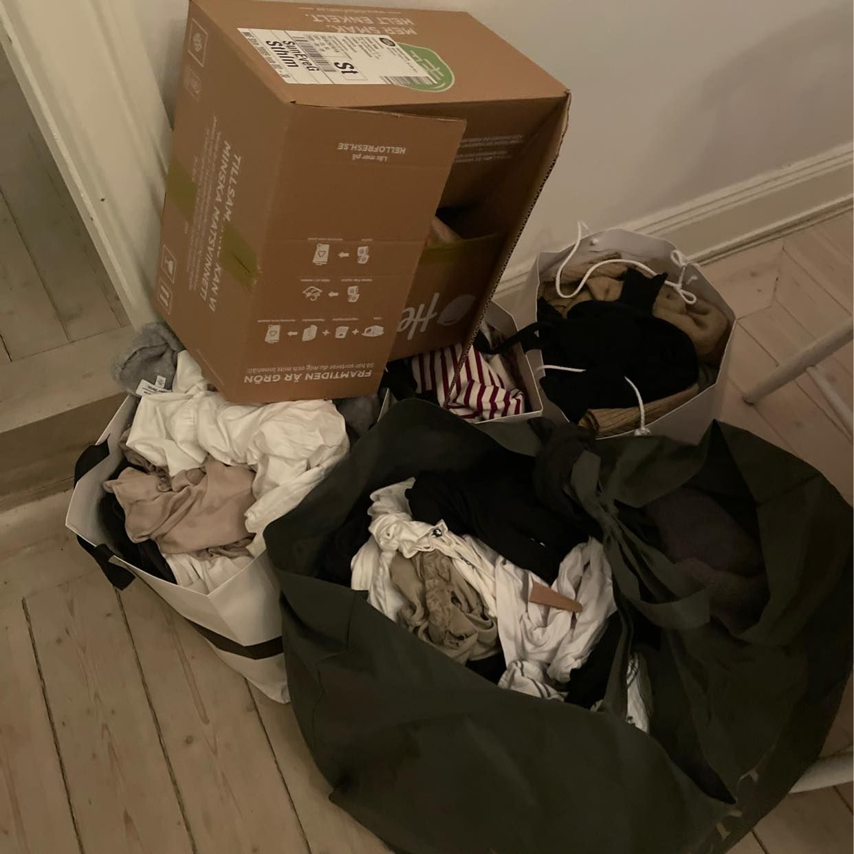 image of 4 large bags with clothes - Stockholm