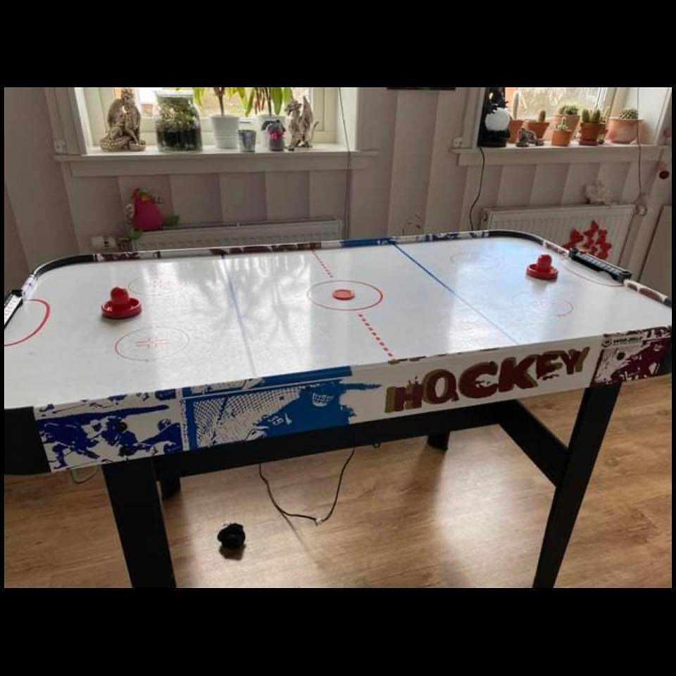 image of Flytta en airhockey bord -